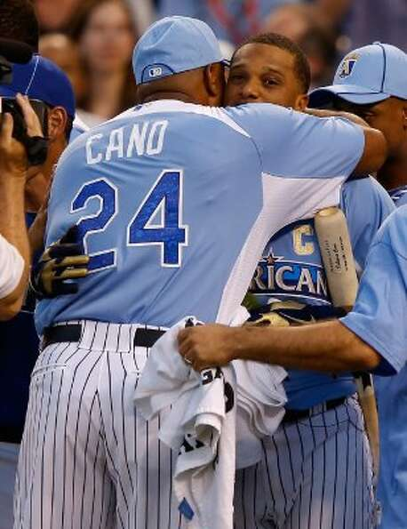 Jose Cano hugs his son American League All-Star Robinson Cano #24 of the New York Yankees after Robi