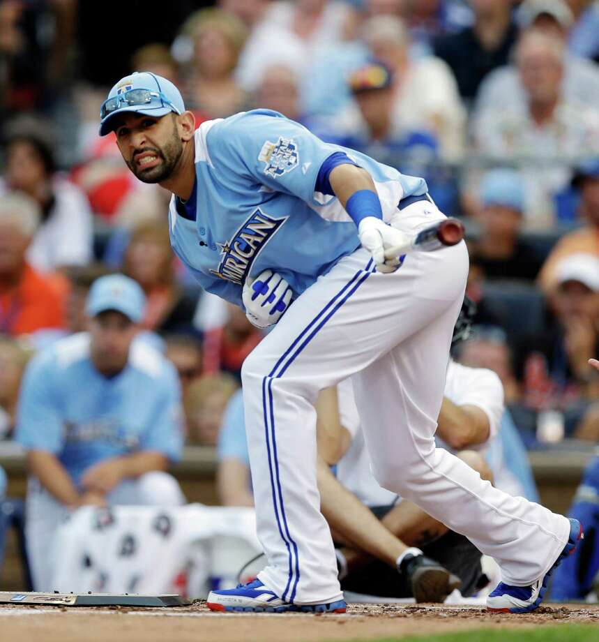 American League's Jose Bautista, of the Toronto Blue Jays, reacts during the MLB All-Star baseball Home Run Derby, Monday, July 9, 2012, in Kansas City, Mo. (AP Photo/Jeff Roberson) Photo: Jeff Roberson