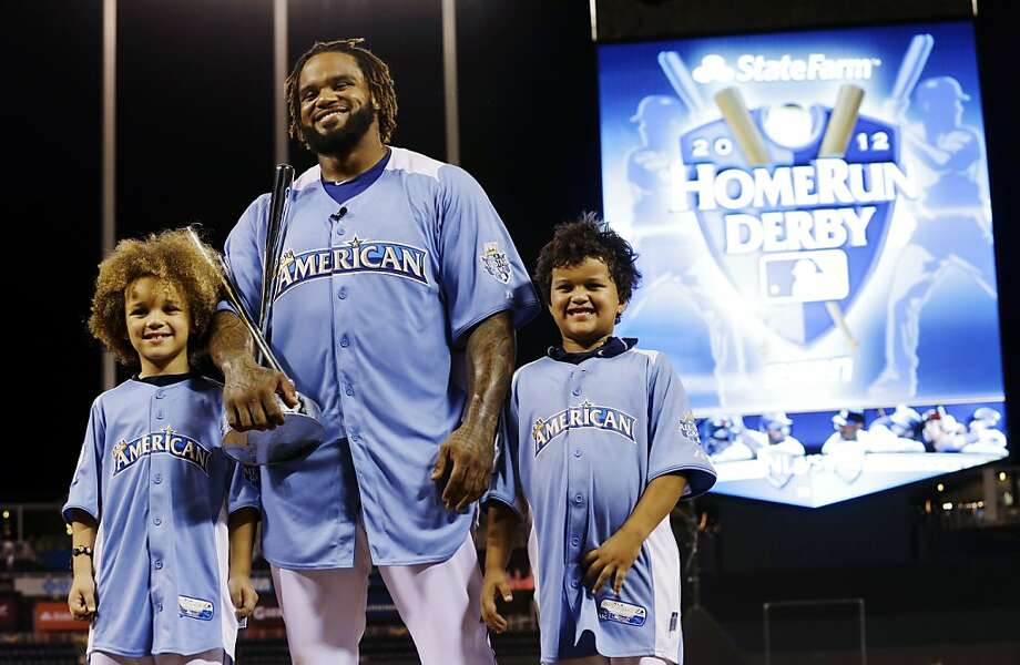 American League's Prince Fielder, of the Detroit Tigers, poses with his children Jaden, left, and Haven after receiving the MLB All-Star baseball Home Run Derby trophy, Monday, July 9, 2012, in Kansas City, Mo. (AP Photo/Charlie Riedel) Photo: Charlie Riedel, Associated Press