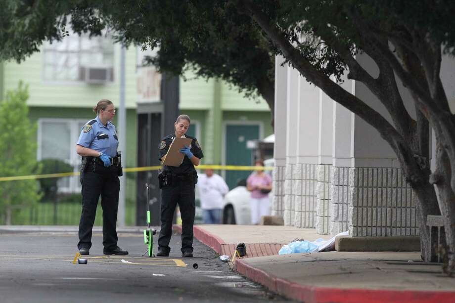 Police investigate an officer-involved shooting Monday in the 7000 block of Bissonnet near Fondren. Authorities say the officer fired on a man after he refused the officer's commands and placed the officer in fear for her safety. Photo: J. Patric Schneider / Houston Chronicle