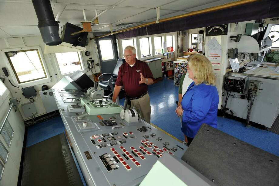 Captain Jack Smith left, gives a tour of the Bridge to Tammy Kotzur, middle, and Jeanette Sanders, right, explaining how they communicate with the engine room.  The Texas Maritime Academy of Texas A&M Galveston was at the Port of Port Arthur giving free tours of its new training vessel, the TS General Rudder Monday July 9, 2012. The purpose of the visit is educational, providing information about the Maritime Academy to the general public and students who might be interested in exploring the many career options.  Dave Ryan/The Enterprise