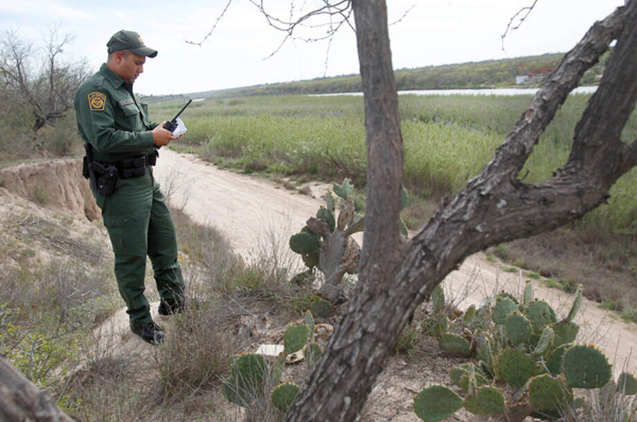 Border Patrol agent Jose Tellez over looks the federal road parallel to the Rio Grande along the U.S. Mexico Border on Tuesday, March 6, 2012, in Eagle Pass, TX.  Tellez has 12 years of experience as a Border Patrol agent, started out of Carrizo Spring station, and then transferred to Eagle Pass Station. The Border Patrol's Del Rio Sector patrols terrain covered with mesquite, sagebrush and cane, some of it 12 feet high.  ( Mayra Beltran / Houston Chronicle ) (Houston Chronicle)