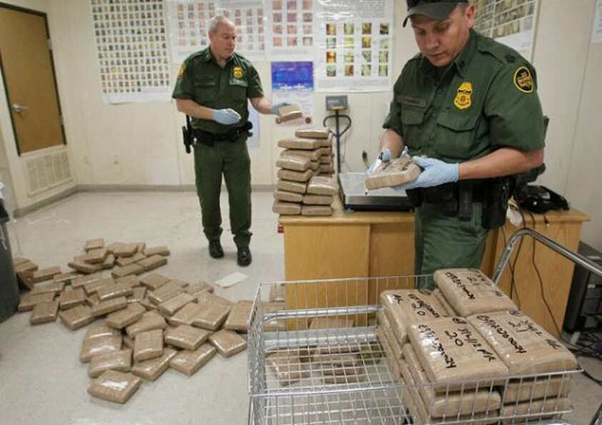 Agent A. Ramirez labels the confiscated marijuana after the official weight in at the Eagle Pass Bor