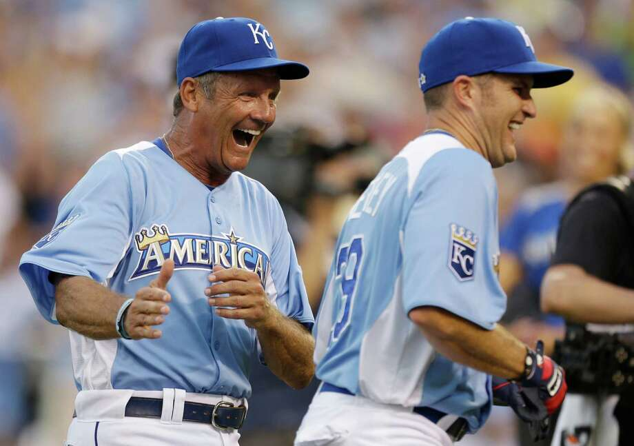 George Brett, left, congratulates Mike Sweeney for his home run during the MLB All-Star celebrity softball game, Sunday, July 8, 2012, in Kansas City, Mo. Photo: Jeff Roberson, AP / AP