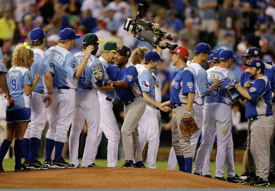 Players congratulate each other after the MLB All-Star celebrity softball game, Sunday, July 8, 2012, in Kansas City, Mo. Photo: Charlie Riedel, AP / AP