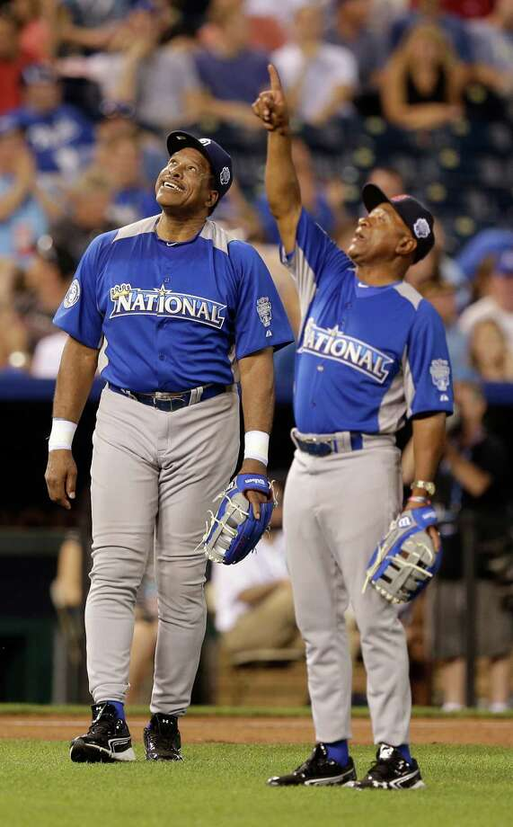 Dave Winfield, left, and Ozzie Smith look up the sky after Winfield misses the fly ball during the MLB All-Star celebrity softball game, Sunday, July 8, 2012, in Kansas City, Mo. Photo: Charlie Riedel, AP / AP