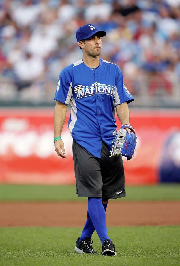 KANSAS CITY, MO - JULY 08:  USA Soccer star Carlos Bocanegra in action during the Taco Bell All-Star Legends & Celebrity Softball Game at Kauffman Stadium on July 8, 2012 in Kansas City, Missouri. Photo: Jamie Squire, Getty Images / 2012 Getty Images