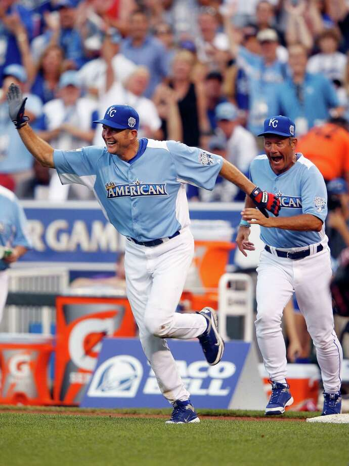 KANSAS CITY, MO - JULY 08:  Former All-Star George Brett celebrates with Mike Sweeney after Sweeney hit a home run during the Taco Bell All-Star Legends & Celebrity Softball Game at Kauffman Stadium on July 8, 2012 in Kansas City, Missouri. Photo: Jamie Squire, Getty Images / 2012 Getty Images