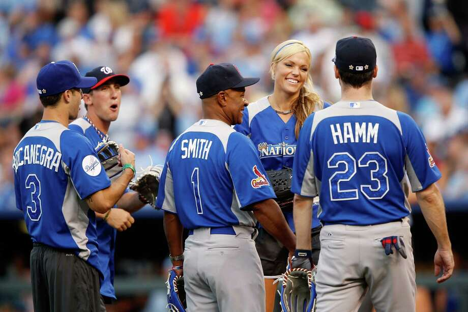 KANSAS CITY, MO - JULY 08:  Jennie Finch jokes with teammates Carlos Bocanegra, Ozzie Smith and John Hamm during the Taco Bell All-Star Legends & Celebrity Softball Game at Kauffman Stadium on July 8, 2012 in Kansas City, Missouri. Photo: Jamie Squire, Getty Images / 2012 Getty Images