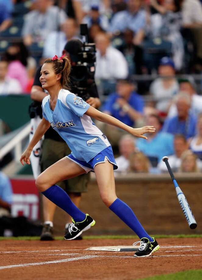 KANSAS CITY, MO - JULY 08:  Chrissy Teigen bats during the Taco Bell All-Star Legends & Celebrity Softball Game at Kauffman Stadium on July 8, 2012 in Kansas City, Missouri. Photo: Jamie Squire, Getty Images / 2012 Getty Images