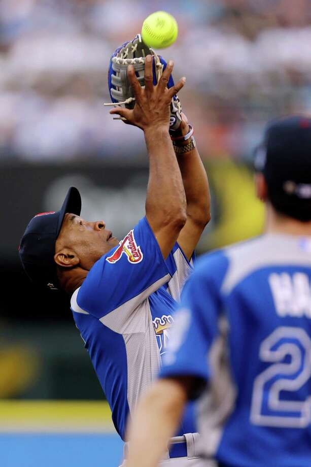 Hall of Famer Ozzie Smith makes a catch during the first inning of the MLB All-Star celebrity softball game, Sunday, July 8, 2012, in Kansas City, Mo. Photo: Jeff Roberson, AP / AP