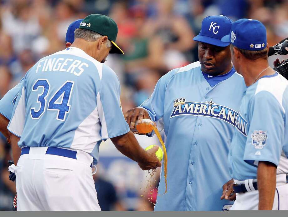 KANSAS CITY, MO - JULY 08:  Coach Bo Jackson juices the ball by pouring Gatorade over it as Rollie Fingers and George Brett look on during the Taco Bell All-Star Legends & Celebrity Softball Game at Kauffman Stadium on July 8, 2012 in Kansas City, Missouri. Photo: Jamie Squire, Getty Images / 2012 Getty Images