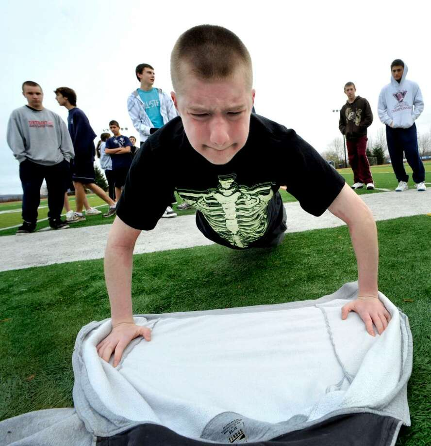 New Fairfield High School Civil Air Patrol student Brian Dodds, a sophmore, struggles on his 14th push-up, during a PE test, early morning on Thursday, Nov.19,2009. Photo: Michael Duffy / The News-Times