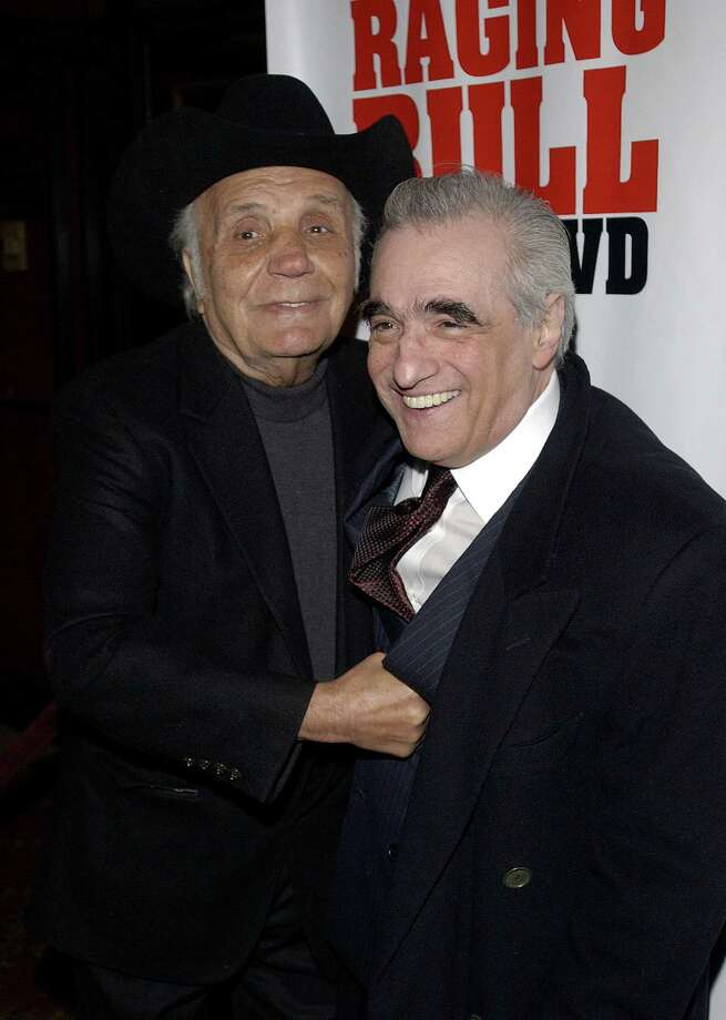 Boxing legend Jake LaMotta greets director Martin Scorsese with a punch as both men arrive to the 25th anniversary screening of the film 'Raging Bull,' in New York, January 27, 2005.    REUTERS/Chip East Photo: CHIP EAST, REUTERS / X01370