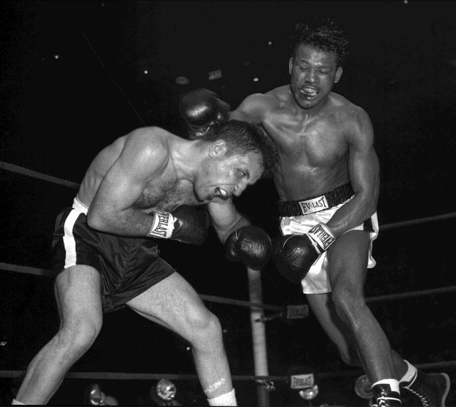 Sugar Ray Robinson, right, battles Jake LaMotta for the middleweight championship at Chicago Stadium, in this Feb. 14, 1951 photo. LaMotta turned 91 years old on Tuesday, July 10. Photo: AP / AP