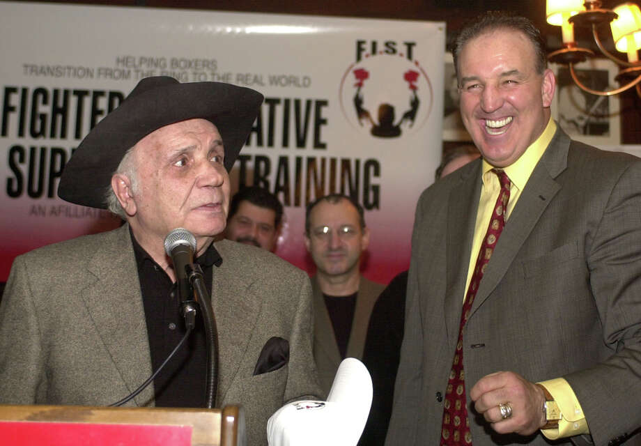 Gerry Cooney, right, former heavyweight contender and F.I.S.T. founder and chairman laughs as Jake LaMotta, former world middleweight champion tells a joke about him at a news conference in New York, Tuesday, March 11, 2003. Photo: ED BAILEY, AP / AP