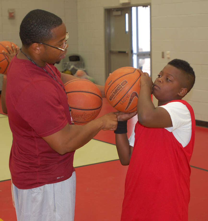 Jasper boys' basketball coach Ted Williams instructs a camper during his basketball camp held this week in Jasper. Photo: Jimmy Galvan