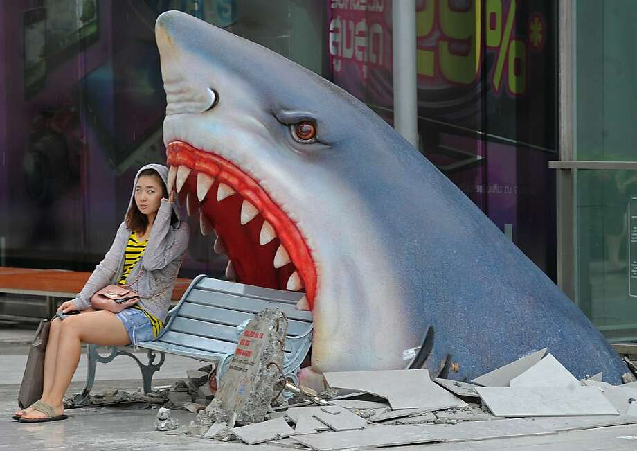 Great whites frequently mistake park benches for seals in Bangkok malls. Photo: Pornchai Kittiwongsakul, AFP/Getty Images