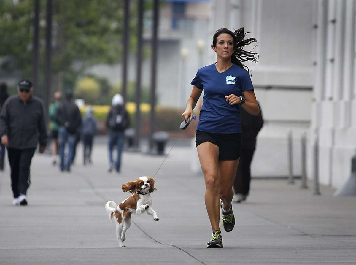 Joanna Reuland trains for the San Francisco Marathon on The Embarcadero with her dog Cooper.