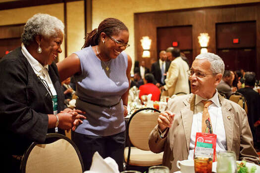 Etta Hill, left, and her daughter Cassandra Hill talk to Julian Bond during Monday's luncheon at the Hilton Americas Hotel. Photo: Michael Paulsen, . / © 2012 Houston Chronicle