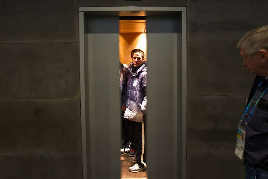 USA speedskater Chad Hedrick of Spring, Texas, is seen through the closing doors of an elevator as the team departs a news conference at the Main Media Center in preparation for the 2010 Winter Olympics on Saturday, Feb. 7, 2010, in Vancouver. ( Smiley N. Pool / Houston Chronicle ) Photo: Smiley N. Pool, Houston Chronicle