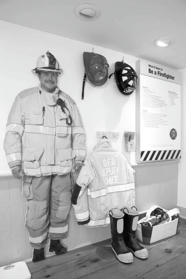 """Everyday Heroes: Greenwich First Responders,"" which chronicles the history of Greenwich's Fire, Police and Emergency Medical Services and other first responders, will be closing its doors at the Greenwich Historical Society on August 26. The exhibition documents headline-making local disasters and chronicles emergency response throughout the town's history. It also includes a hands-on gallery where kids can try on actual fire and police gear and learn what it takes to become a first responder. Photo: Contributed Photo"