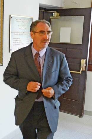 Troy restauranteur Michael LoPorto steps out of the courtroom in the Rensselaer County Courthouse in Troy, N.Y. during a break in his ballot fraud case in which jury selection is continuing July 10, 2012.   (Skip Dickstein / Times Union) Photo: SKIP DICKSTEIN