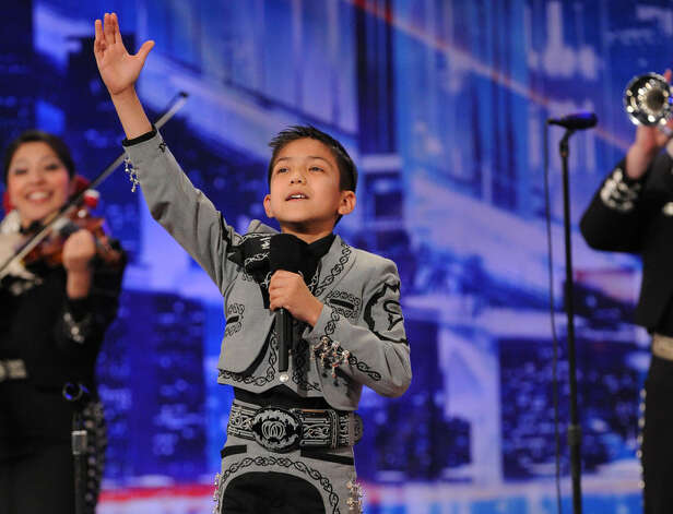 "Sebastien De La Cruz, 9, who placed first in the elementary vocal competition of the recent Mariachi Vargas Extravaganza, had advanced to the second round of competition on ""America's Got Talent      Read more: http://www.mysanantonio.com/sacultura/conexion/article/2-area-kids-land-Talent-invitations-2471041.php#ixzz1wSxAkZ8e Photo: Courtesy"