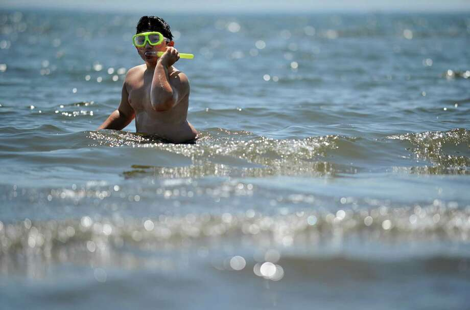 Eight-year-old Damon Pasacreta, of West Haven, snorkels in the Long Island Sound Tuesday, July 10, 2012 at Seaside Park in Bridgeport, Conn. Photo: Autumn Driscoll / Connecticut Post