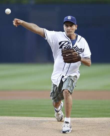 Entertainer Charlie Sheen throws out out the first pitch at the baseball game between the San Diego
