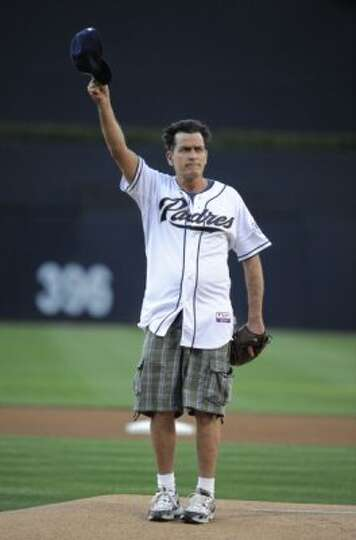 SAN DIEGO, CA - JULY 7:  Actor Charlie Sheen acknowledges the fans before throwing out the first pit