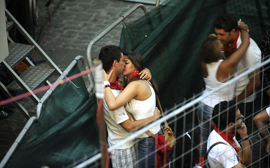 Two couples kiss each other as they wait for the fourth Bull Run of the San Fermin festival, in the Northern Spanish city of Pamplona, on July 10, 2012. AFP PHOTO / Rafa RivasRAFA RIVAS/AFP/GettyImages Photo: Rafa Rivas, AFP/Getty Images