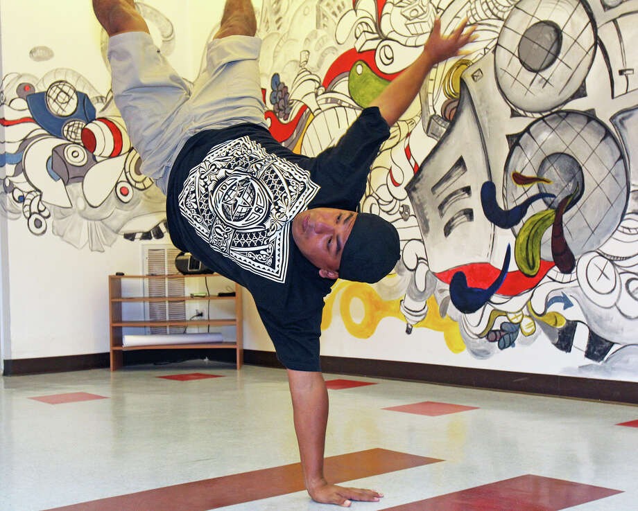 Omar Davila performs some break dance moves as he prepares for the three day hip hop festival, Art of War.   July 5, 2012. Photo: Tom Reel, San Antonio Express-News / ©2012 San Antono Express-News