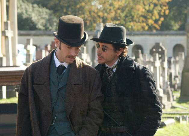 The success of the Sherlock Holmes films starring Jude Law, left, and Robert Downey Jr. has led to new approaches to the genre. Photo: ALEX BAILEY, Photographer / handout