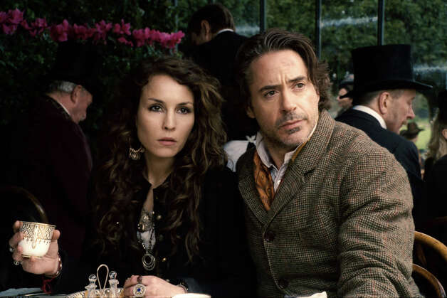 "In this film image released by Warner Bros. Pictures, Noomi Rapace, left, and Robert Downey Jr. are shown in a scene from ""Sherlock Holmes: A Game of Shadows.""  Two and a half years after the debut of ìDragon Tattoo,î the first of her three eye-popping turns as late author Stieg Larsson's untamed heroine, Rapace has stormed into Hollywood in Robert Downey Jr.'s latest Sherlock Holmes adventure. (AP Photo/Warner Bros. Pictures) Photo: Anonymous, HONS / © 2011 Warner Bros. Entertainment Inc. - - U.S., Canada, Bahamas & Bermuda © 2011 Village Roadshow Films (BVI) Limited - - All o"