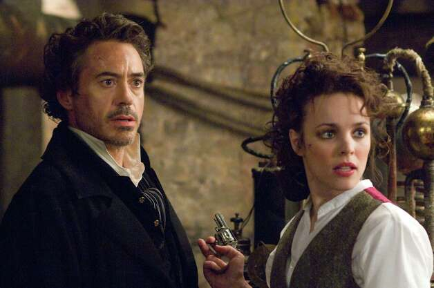 "In this film publicity image released by Warner Bros. Pictures, Robert Downey Jr., left, and Rachel McAdams are shown in a scene from ""Sherlock Holmes."" (AP Photo/Warner Bros. Pictures, Alex Bailey) Photo: ALEX BAILEY, HO"