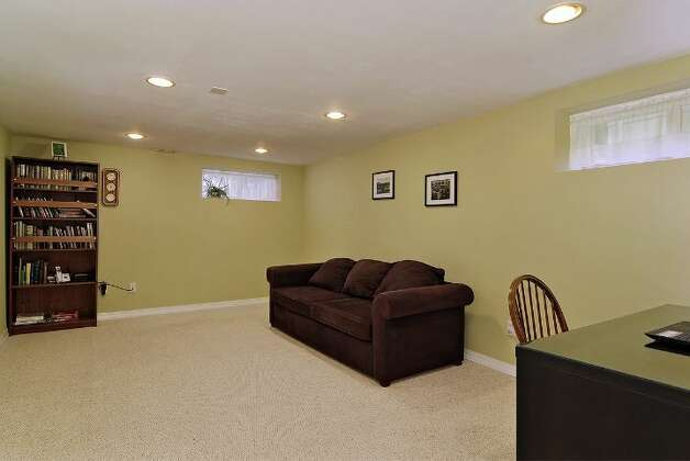 Downstairs family room of 4045 2nd Ave. N.E. The 1,925-square-foot Cape Cod-style house, built in 1937, has three bedrooms, 1.75 bathrooms a patio on a 4,000-square-foot lot. It's listed for $615,000. Photo: Courtesy Patty Allen/Windermere Real Estate