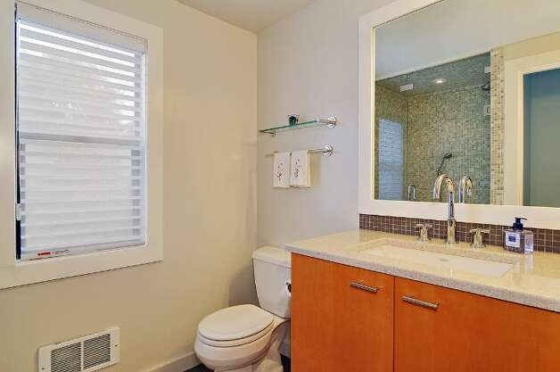 Upstairs bathroom of 4045 2nd Ave. N.E. The 1,925-square-foot Cape Cod-style house, built in 1937, has three bedrooms, 1.75 bathrooms, a downstairs family room and a patio on a 4,000-square-foot lot. It's listed for $615,000. Photo: Courtesy Patty Allen/Windermere Real Estate