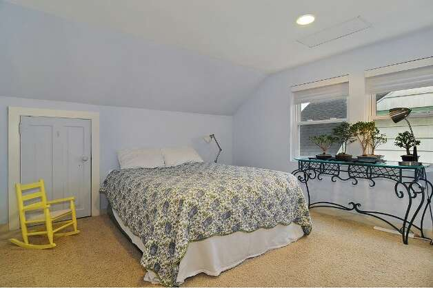 Upstairs bedroom of 4045 2nd Ave. N.E. The 1,925-square-foot Cape Cod-style house, built in 1937, has three bedrooms, 1.75 bathrooms, a downstairs family room and a patio on a 4,000-square-foot lot. It's listed for $615,000. Photo: Courtesy Patty Allen/Windermere Real Estate