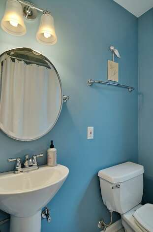 Main-floor bathroom of 4045 2nd Ave. N.E. The 1,925-square-foot Cape Cod-style house, built in 1937, has three bedrooms, 1.75 bathrooms, a downstairs family room and a patio on a 4,000-square-foot lot. It's listed for $615,000. Photo: Courtesy Patty Allen/Windermere Real Estate