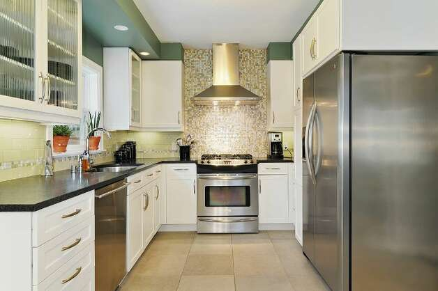 Kitchen of 4045 2nd Ave. N.E. The 1,925-square-foot Cape Cod-style house, built in 1937, has three bedrooms, 1.75 bathrooms, a downstairs family room and a patio on a 4,000-square-foot lot. It's listed for $615,000. Photo: Courtesy Patty Allen/Windermere Real Estate
