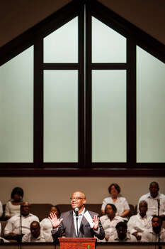 Pastor Timothy Sloan speaks of the importance of HIV/AIDS prevention while sharing the results of his free HIV test during the church service at St. Luke Missionary Baptist Church on Sunday. Photo: Michael Paulsen, . / © 2012 Houston Chronicle