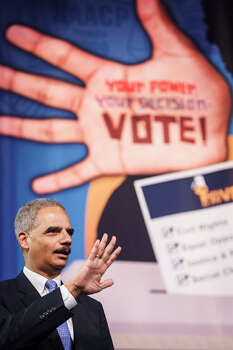 """""""Under the proposed law, concealed handgun licenses would be acceptable forms of photo ID, but student IDs would not,"""" Holder tells the crowd. Photo: Michael Paulsen, . / © 2012 Houston Chronicle"""