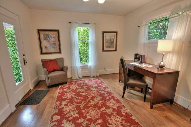 Bedroom of 2208 N. 44th St. The 2,482-square-foot Craftsman house, built in 1918, has four bedrooms, two bathrooms, box-beam ceilings, pocket doors, wainscoting, skylights and a front porch on a 3,135-square-foot lot. It's listed for $639,500. Photo: Courtesy Liz Talley And Bruce Barnum/Windermere Real Estate