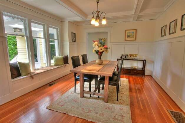 Dining room of 2208 N. 44th St. The 2,482-square-foot Craftsman house, built in 1918, has four bedrooms, two bathrooms, box-beam ceilings, pocket doors, wainscoting, skylights and a front porch on a 3,135-square-foot lot. It's listed for $639,500. Photo: Courtesy Liz Talley And Bruce Barnum/Windermere Real Estate