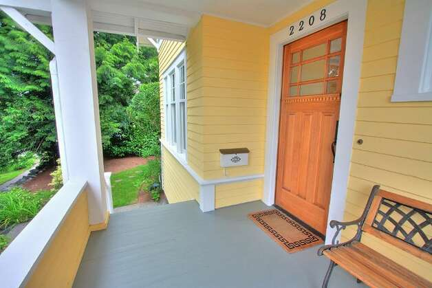 Front porch of 2208 N. 44th St. The 2,482-square-foot Craftsman house, built in 1918, has four bedrooms, two bathrooms, box-beam ceilings, pocket doors, wainscoting and skylights on a 3,135-square-foot lot. It's listed for $639,500. Photo: Courtesy Liz Talley And Bruce Barnum/Windermere Real Estate