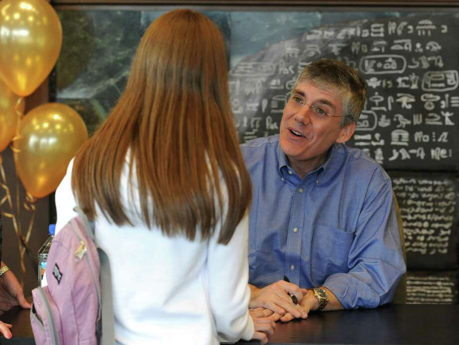 New York Times best selling author Rick Riordan signed his new book the Serpent's Shadow the final book in the Kane Chronicles series at Barnes and Noble in Anchorage, AK on Saturday, May 5, 2012. Riordan is the author of Percy Jackson, Kane Chronicles and Heroes of Olympus books for young readers as well as the award winning adult Tres Navarre mystery series. Photo: AP