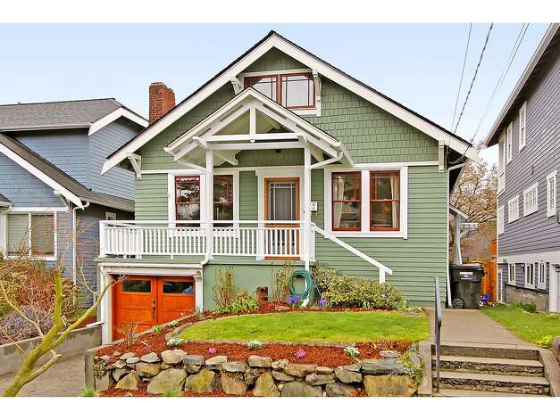 Our priciest home is 3929 Ashworth Ave. N., listed for $665,000. The 2,585-square-foot Craftsman, built in 1924, has five bedrooms and 2.5 bathrooms -- including a lower level with two bedrooms, a media room, a five-piece bathroom and a kitchenette -- built-in shelves, a balcony, a front porch and a back deck on a 3,579-square-foot lot. Photo: Courtesy Richae Fox And Carolyn Holm/Windermere Real Estate