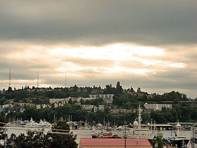 View of Lake Union from 1730 N. Northlake Way, Unit 311. The 1,069-square-foot home, built in 2002, has two bedrooms, two bathrooms, a gas fireplace, picture windows and a wrap-around deck. It's listed for $638,000. Photo: Mark Anderson/John L. Scott Real Estate