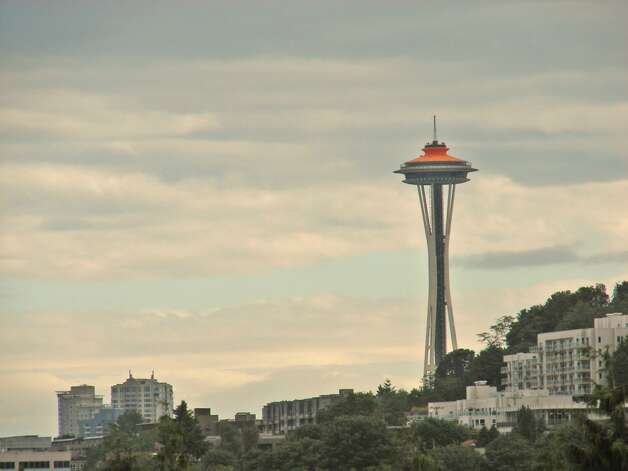 View of Space Needle from 1730 N. Northlake Way, Unit 311. The 1,069-square-foot home, built in 2002, has two bedrooms, two bathrooms, a gas fireplace, picture windows and a wrap-around deck. It's listed for $638,000. Photo: Mark Anderson/John L. Scott Real Estate
